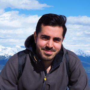 Adam Hussein Marketing Director smiling in jacket